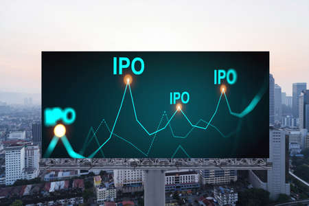 IPO icon hologram on road billboard over sunset panorama city view of Kuala Lumpur. KL is the hub of initial public offering in Malaysia, Asia. The concept of exceeding business opportunities. Stock Photo