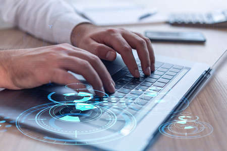 Hands typing the keyboard to create innovative software to change the world and provide a completely new service. Close up shot. Hologram tech graphs. Concept of Dev team. Formal wear. Stock fotó