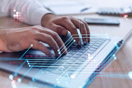 Hands typing the keyboard to create innovative software to change the world and provide a completely new service. Close up shot. Hologram tech graphs. Concept of Dev team. Formal wear.
