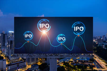 IPO icon hologram on road billboard over night panorama city view of Kuala Lumpur. KL is the hub of initial public offering in Malaysia, Asia. The concept of exceeding business opportunities.