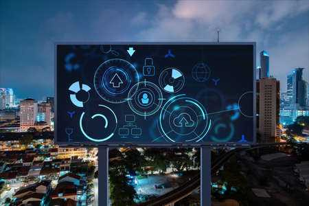 Information flow hologram on road billboard, night panorama city view of Kuala Lumpur. KL is the largest technological center in Malaysia, Asia. The concept of programming science.
