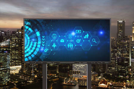 Research and technological development glowing icons on billboard. Night panoramic city view of Singapore. Concept of innovative activities expanding new services or products in Southeast Asia.