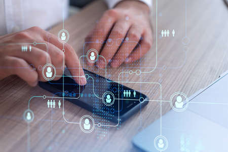 Hands of hr specialist browsing social networks in the Internet in smart phone to find the best candidates to hire international team. Concept of success. Media hologram icons. Formal wear.