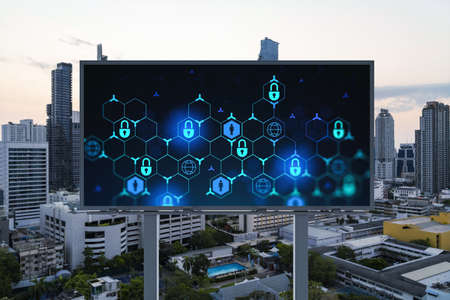 Padlock icon hologram on road billboard over panorama city view of Bangkok at sunset to protect business, Southeast Asia. The concept of information security shields.