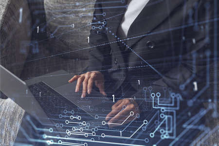 Woman typing the keyboard to create innovative software to change the world and provide a completely new service. Close up shot. Hologram tech graphs. Concept of Dev team. Formal wear. Stock fotó