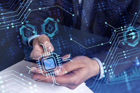 Programmer holding in the hands a smart phone and testing an innovative application to provide a completely new service. Close up shot. Hologram tech graphs. Concept of Dev team. Formal wear. Stock fotó