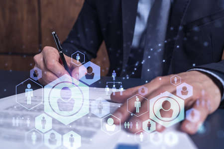 A potential employee in formal suit signing the contract to boost his career and gain new opportunities in personal growth. Concept of success. Hiring a new talented crew. Social media hologram icons