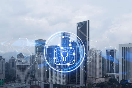 Hologram of padlock icons over panoramic city view of Kuala Lumpur to protect business, Malaysia, Asia. The concept of information security shields. Double exposure.