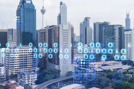 Social media icons hologram over panorama city view of Kuala Lumpur, Malaysia, Asia. The concept of people networking, connections and career opportunities. Double exposure. Stock fotó