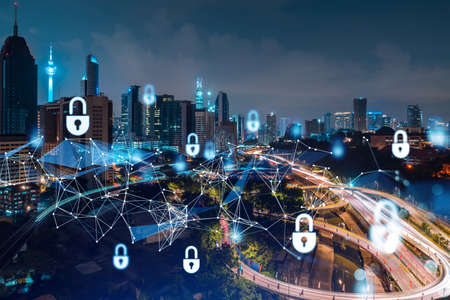 Glowing padlock hologram, night panoramic city view of Kuala Lumpur, Malaysia, Asia. The concept of cyber security shields to protect KL companies. Double exposure. Stock fotó