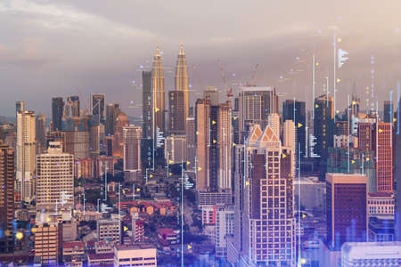 Glowing FOREX graph hologram, aerial panoramic cityscape of Kuala Lumpur at sunset. Stock and bond trading in KL, Malaysia, Asia. The concept of fund management. Double exposure. Stock fotó