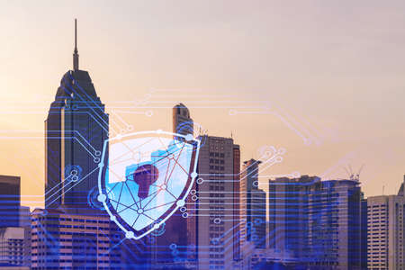 Padlock hologram on sunset panoramic cityscape of Kuala Lumpur, Malaysia, Asia. The concept of cyber security intelligence in KL. Multi exposure.