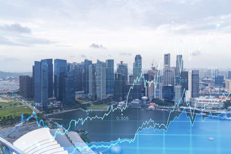 Financial stock chart hologram over panorama city view of Singapore, business center in Asia. The concept of international transactions. Double exposure.