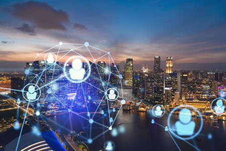 Glowing Social media icons on night panoramic city view of Singapore, Asia. The concept of networking and establishing new connections between people in businesses. Double exposure. Stock fotó