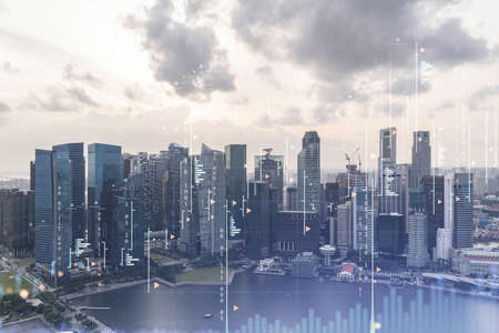 Glowing FOREX graph hologram, aerial panoramic cityscape of Singapore at sunset. Stock and bond trading in Southeast Asia. The concept of fund management. Double exposure.