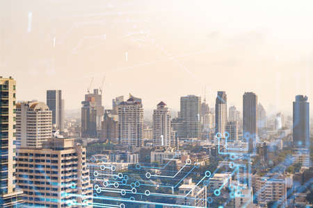 Technology hologram over panorama city view of Bangkok. The largest tech hub in Southeast Asia. The concept of developing coding and high-tech science. Double exposure. Stock fotó