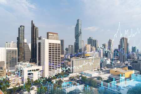 Financial stock chart hologram over panorama city view of Bangkok, business center in Southeast Asia. The concept of international transactions. Double exposure.