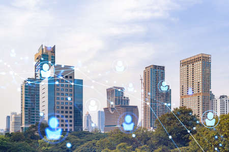 Social media icons hologram over panorama city view of Bangkok, Southeast Asia. The concept of people networking, connections and career opportunities. Double exposure.