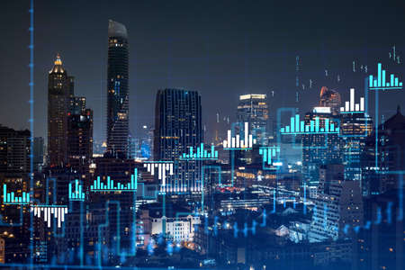 Stock market graph hologram, night panorama city view of Bangkok, popular location to gain financial education in Southeast Asia. The concept of international research. Double exposure.