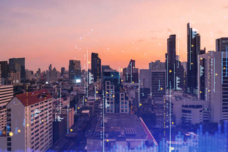 Glowing FOREX graph hologram, aerial panoramic cityscape of Bangkok at sunset. Stock and bond trading in Southeast Asia. The concept of fund management. Double exposure.