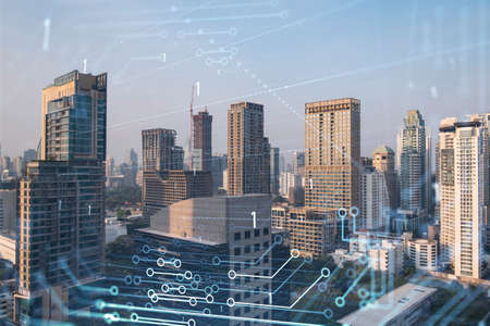 Glowing hologram of technological process, aerial panoramic cityscape of Bangkok at sunset. The largest innovative hub of tech services in Southeast Asia. Multi exposure.