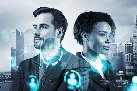 Businessman and businesswoman as a SMM specialists thinking about development of social media marketing strategy to achieve business goals. Hologram icons over Singapore background.
