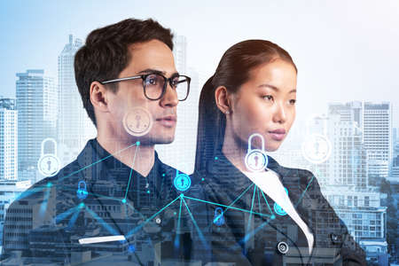 Two colleagues in multinational corporate team thinking about career opportunities at cybersecurity compliance division to protect clients confidential information. IT lock icons over Bangkok. Stock fotó