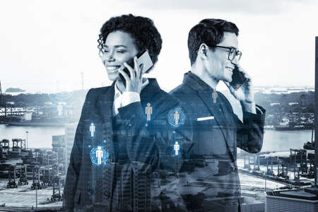 Businessman and businesswoman as a part of corporate team processing conference call to develop social media marketing strategy to achieve business goals. Hologram icons over Singapore background