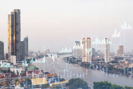Forex and stock market chart hologram over panorama city view of Bangkok, the financial center in Southeast Asia. The concept of international trading. Double exposure.