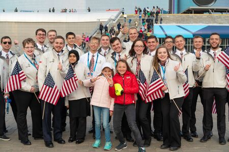 Russia, Kazan - August 27, 2019: A group of participants Championship from America with Russian fans in the fan zone during the WorldSkills Kazan 2019 China Russia - Image. Students from USA with flags posing for the photographer.