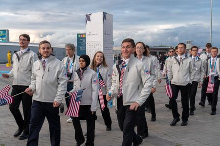 Russia, Kazan - August 27, 2019: A group of participants Championship from America in the fan zone during the WorldSkills Kazan 2019 China Russia - Image. Students from USA with flags posing for the photographer.