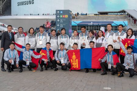 Russia, Kazan - August 27, 2019: A group of participants Championship from Mongolia in the fan zone during the WorldSkills Kazan 2019 China Russia - Image. Students from Mongolia with flags posing for the photographer Redakční