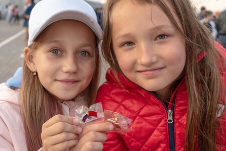 Russia, Kazan - August 27, 2019: World Skills 2019 China Russia badges in the hands of two girls. Redakční