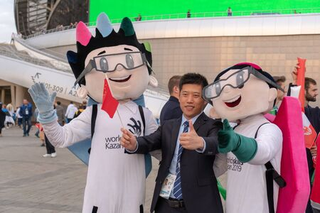 Russia, Kazan - August 27, 2019: Portrait of a Chinese fan with animators with the championship emblem in the fan zone during the WorldSkills Kazan 2019 China Russia - Image
