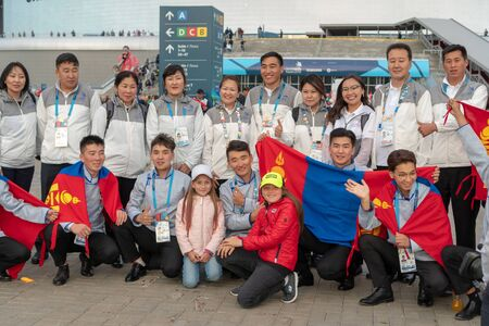 Russia, Kazan - August 27, 2019: A group of participants Championship from Mongolia with Russian fans in the fan zone during the WorldSkills Kazan 2019 China Russia - Image. Students from Mongolia with flags posing for the photographer