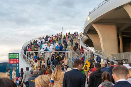 Russia, Kazan - August 27, 2019: A crowd of spectators goes up the stairs to the stadium