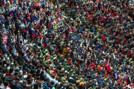 Russia, Kazan - August 27, 2019: Blurred crowd of spectators on a stadium tribune at a sporting event. Redakční