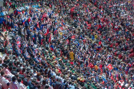 Russia, Kazan - August 27, 2019: crowd of spectators on a stadium tribune at a sporting event.