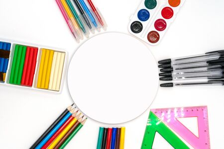Colorful school supplies in circle arrangement on white background, back to school concept. Sale of school supplies and stationery. round Space for text Stockfoto