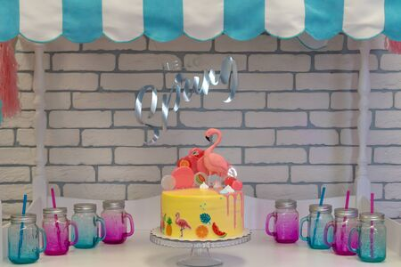 Flamingo cake at the Hawaiian party. Childrens birthday cake at Candy Bar. text Hello spring