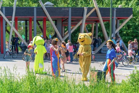Children have fun in the park. Green rabbit Animator and bear winnie the pooh Animator hare entertains children in the park on a sunny clear day. Russia, Tatarstan, May 31, 2019