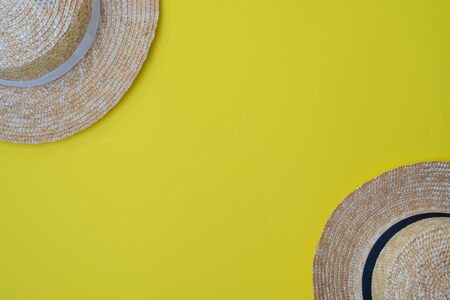 Modern stylish boater straw hats on a yellow background.Trip, travel and tourism concept. Space for text Stock Photo