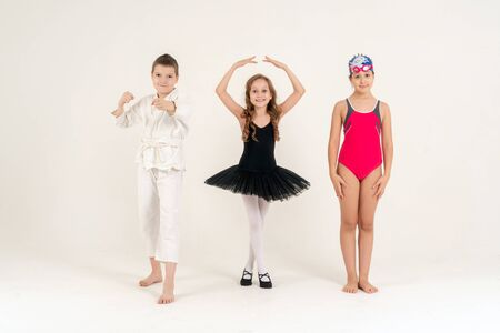Sports and activities for children. Group of joyful boys and a girls engaged in various sports posing together. Education. Reklamní fotografie