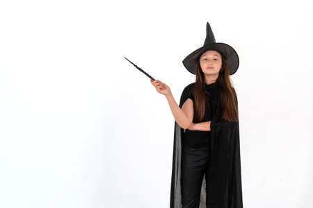 A girl dressed as Harry Potter with a magic wand in her hands