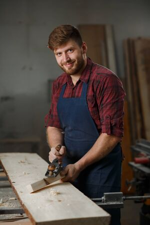 Portrait Male Master carpenter apron in his workshop. Small business