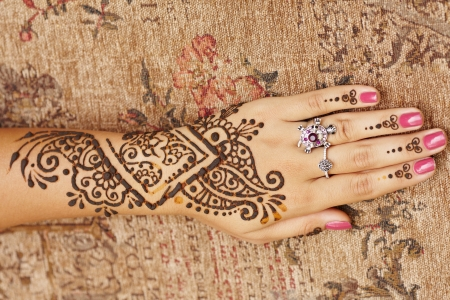 henna tattoo: The Indian pattern is drawn a girl. Mehandi