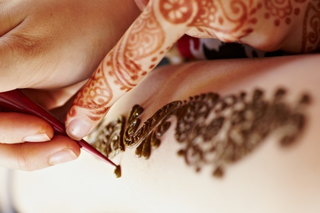 The Indian pattern is drawn a girl. Mehandi