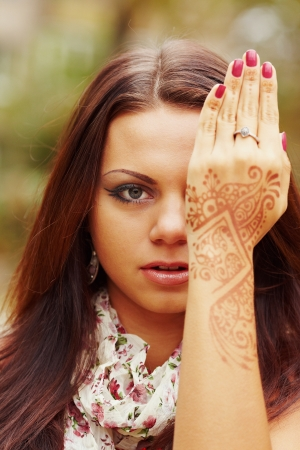 ceremonial make up: Girl with hands painted Mehandi  Picture by a henna