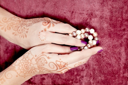 The Indian pattern is drawn a girl  Mehandi photo