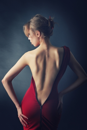 Beautiful girl back  Dress unbuttoned to the buttocks  Stock Photo - 17823900
